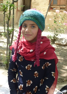 Nilufar with her self knitted  cap.